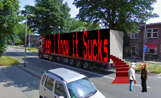 Harco Rutgers (owner and representative of Esc.rec. follows your host KN towards the back of the YIKIS studio truck. The door opens, a little red carpet rolls out and the two walk into the professional looking late night show setting.