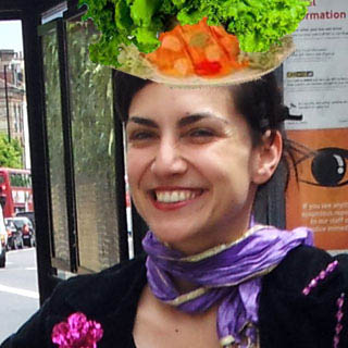 ^ Djanan Turan smiles even more if you want to be that special person who requests a handmade salad hat